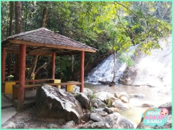 Rest hut in front of the waterfall.