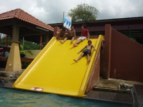 Water slide at open family pool.